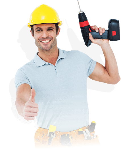 man holding an electric hand drill smiling